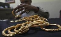 Gold struggles as dollar firms ahead of U.S. jobs data