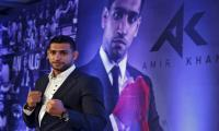 Khan pledges to give Alvarez a lesson in the ring