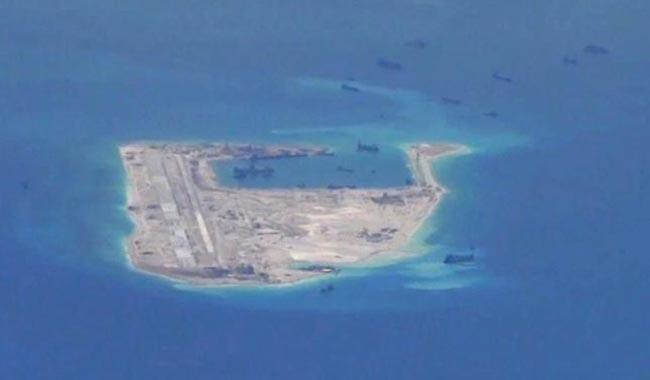 China scrambles fighters as US sails warship near Chinese-claimed reef