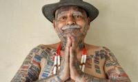 This Indian man removes teeth and gets over 500 tattoos for world records
