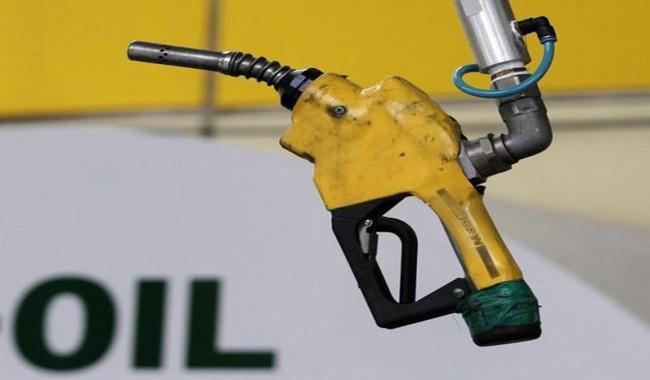 Oil dips after hitting $50 per barrel; U.S. stocks steady