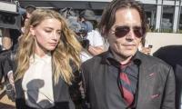 Amber Heard accuses estranged husband Johnny Depp of domestic violence