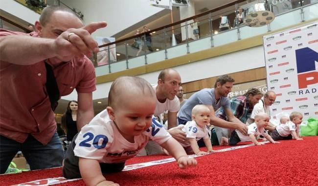 The fastest toddler in Lithuania lured across finish line by jangling keys