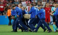 Ronaldo swerves Euro pitch invader
