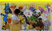 Japan warns on Pokemon GO safety as impatient gamers await launch