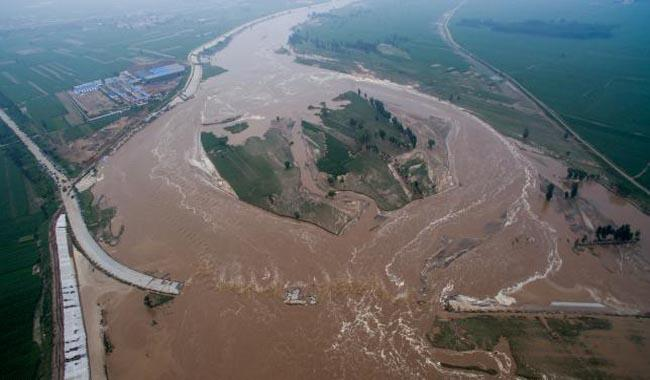 Heavy rain in China kills at least 87, millions evacuated