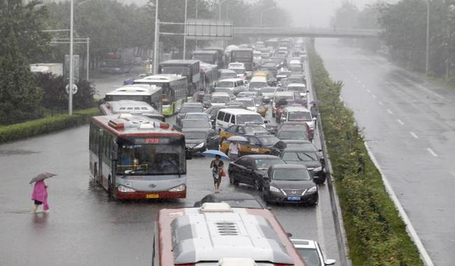 Heavy rain in China kills at least 87, millions evacuated