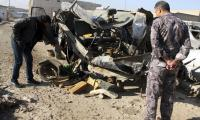 Suicide car bomber kills at least 14 north of Baghdad - police