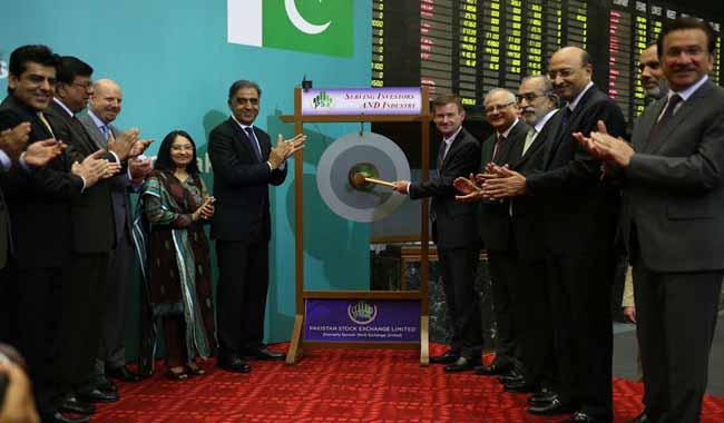 US Ambassador rings the trading bell at Stock Exchange