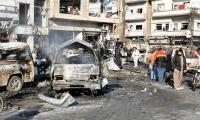 Bombings kill at least 31 in northeast Syria city, state TV says