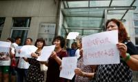 Chinese relatives of those on MH370 ask for search to continue