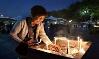 Japan remembers Hiroshima, urges world to follow Obama and visit