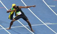 ´Lightning´ strikes thrice as Bolt completes 100m hat-trick