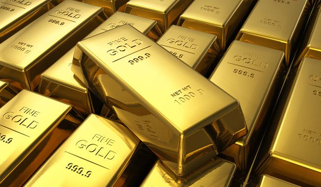 Gold hits near 5-week low after Fed strikes hawkish note