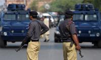 Seven held in Karachi raids