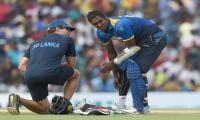Aussie bouncer breaks Sri Lanka skipper´s helmet