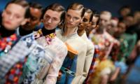 Feathers and nostalgia add glam to Prada spring collection