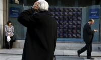 Asian shares mixed, oil jumps on output curb expectations