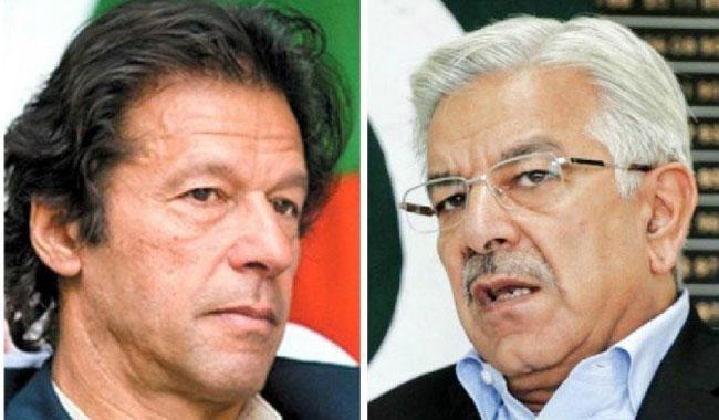 Imran, Khawaja Asif take off gloves in latest verbal spat