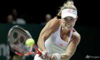 Kerber survives Cibulkova test at WTA Final
