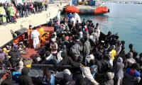 Cheers and tears as migrant survivors make it to Italy