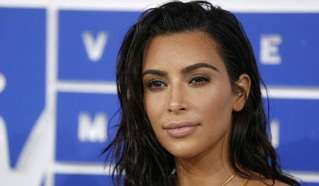 Kim Kardashian resumes filming E! reality TV show after robbery