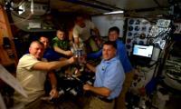 Astronauts enjoy a zero-gravity 'Spacegiving' dinner