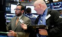 Wall Street ends at record highs; dollar loses steam
