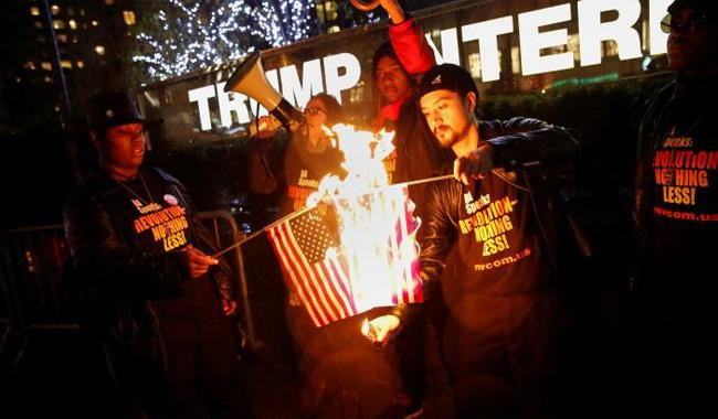 Trump flag-burning tweet leads activists to burn some flags