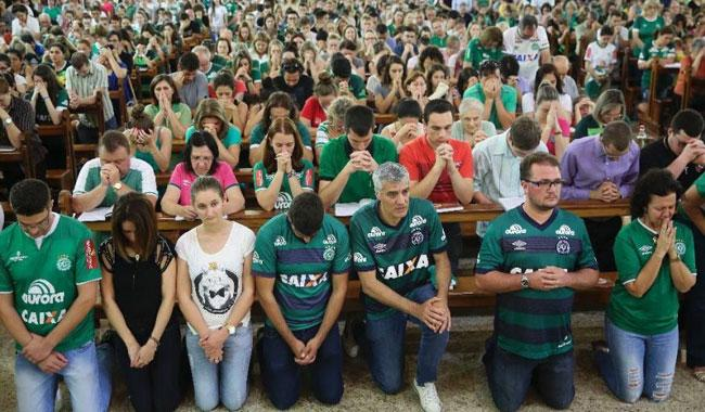 Fans mass at Brazil football stadium to mourn dead players