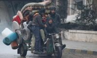 Rebels seek ceasefire with Syrian army closer to retaking Aleppo