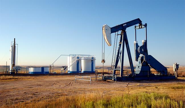 Oil prices edge up despite unexpected U.S. crude inventory build