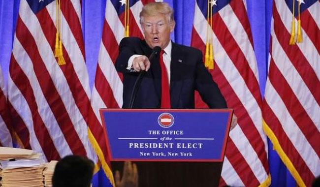 Trump accuses U.S. spy agencies of Nazi practices