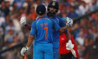 Yuvraj, Dhoni tons power India to 381-6 against England