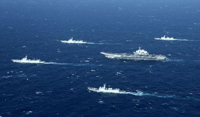 White House warns China on trade, South China Sea
