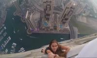 Dubai police summon Russian model who dangled from skyscraper