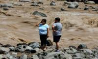 Water slowly restored in Chile capital after deadly floods