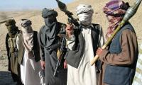 Taliban kill 12 Afghan police with silenced weapons