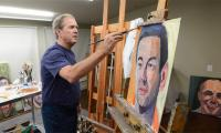 George W. Bush exhibits his portraits of US war veterans