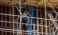 Saudis to tighten curbs on foreign workers in local jobs push