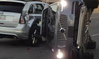 Uber grounds self-driving cars after accident