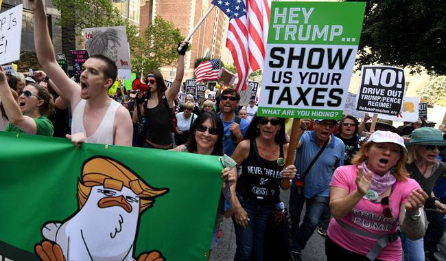 Anti-Trump protesters across US press him on tax returns