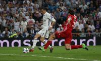 Ronaldo hat-trick fires Real into semis