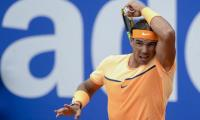 Nadal cruises in Barcelona, Murray gets walkover