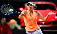 Sharapova wins first match back after doping ban