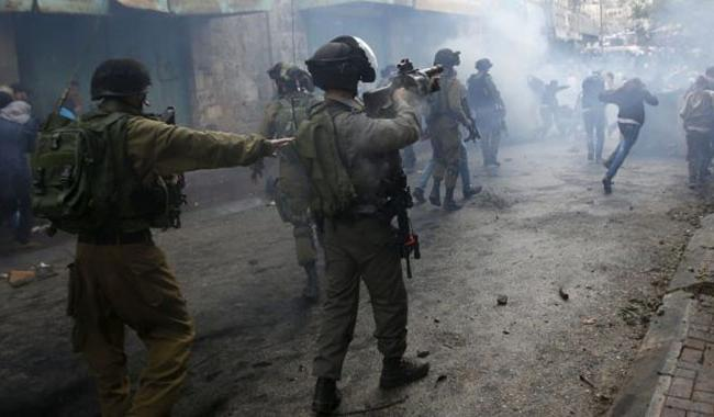 ´Dozens hurt´ as Palestinians clash with Israeli forces