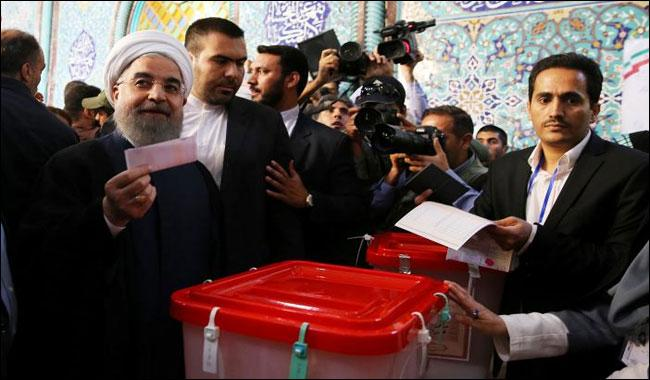 Iran President Rouhani leading in election: official