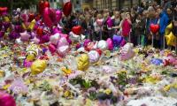 Manchester marks week since attack as intelligence questions grow