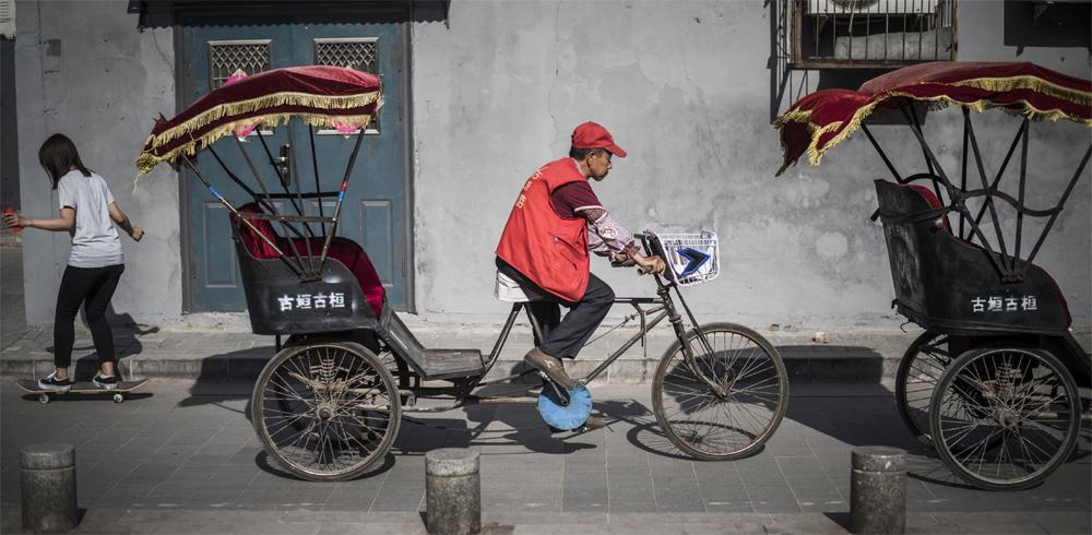 Beijing´s rickshaws teeter between traditions, survival