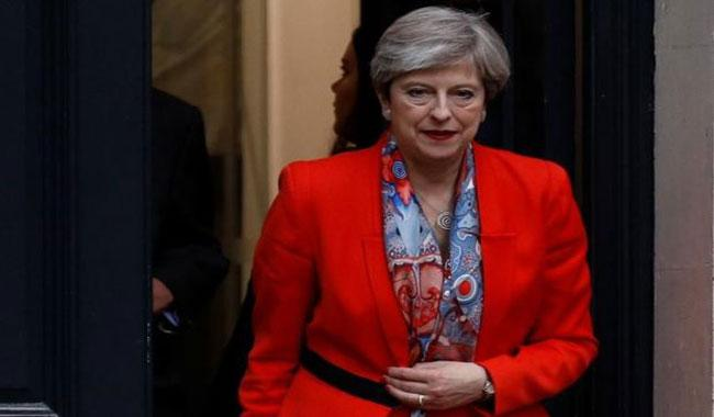 Defiant May vows to stay on despite UK election blow